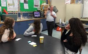 Wittmann Battenfeld representative visits Torrington Middle School W.R.I.C.A. science classes to discuss industrial robotics.